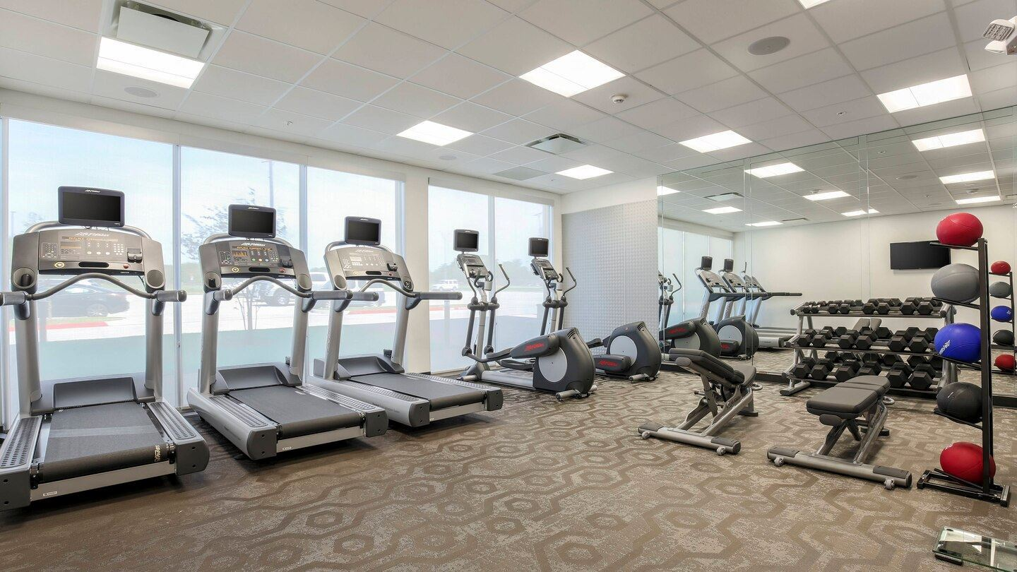 Fitness room with work out machines and weights